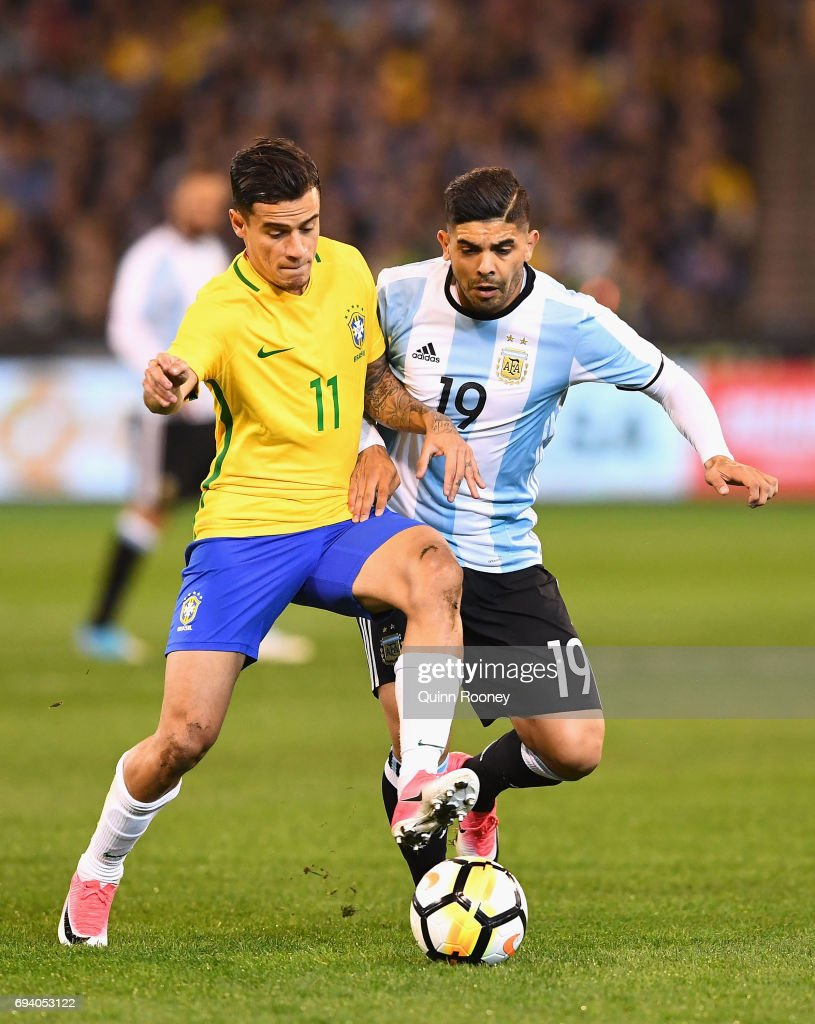 Philippe Coutinho of Brazil and Ever Banega of Argentina compete for the ball during the Brazil Global Tour match between Brazil and Argentina at Melbourne Cricket Ground on June 9, 2017 in Melbourne, Australia.