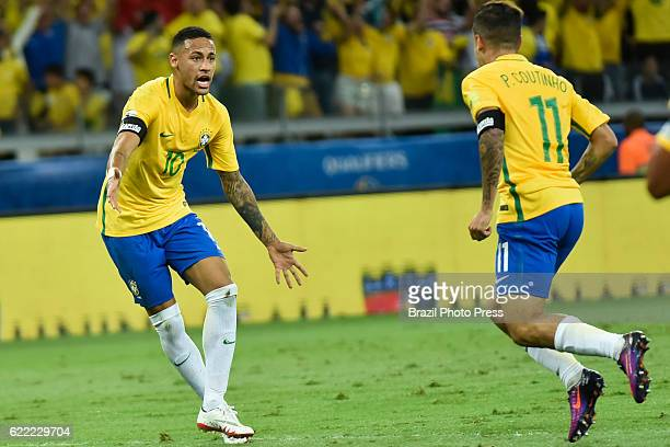 Philippe Coutinho of Brazil celebrates with teammate Neymar Jr after scoring the opening goal during a match between Argentina and Brazil as part of...