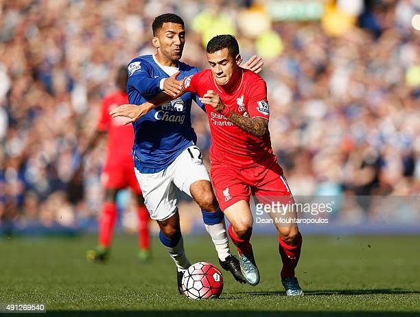 Philippe Coutinho of Liverpool and Aaron Lennon of Everton in action during the Barclays Premier League match between Everton and Liverpool at...