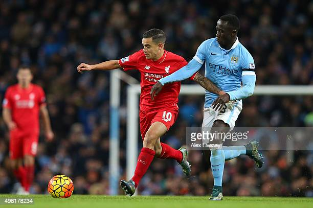 Philippe Coutinho of Liverpool and Bacary Sagna of Manchester City compete for the ball during the Barclays Premier League match between Manchester...