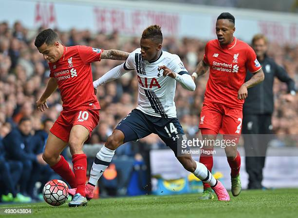 Philippe Coutinho of Liverpool and Clinton N'Jie of Tottenham Hotspur compete for the ball during the Barclays Premier League match between Tottenham...
