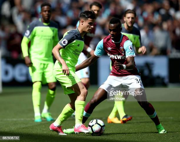Philippe Coutinho of Liverpool and Edimilson Fernandes of West Ham United compete for the ball during the Premier League match between West Ham...