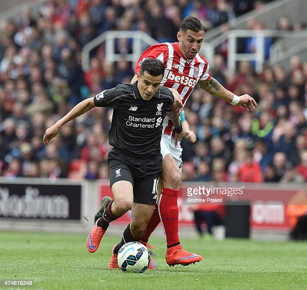 Philippe Coutinho of Liverpool and Geoff Cameron of Stoke City during the Barclays Premier League match between Stoke City and Liverpool at the...