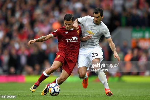 Philippe Coutinho of Liverpool and Henrikh Mkhitaryan of Manchester United battle for possession during the Premier League match between Liverpool...