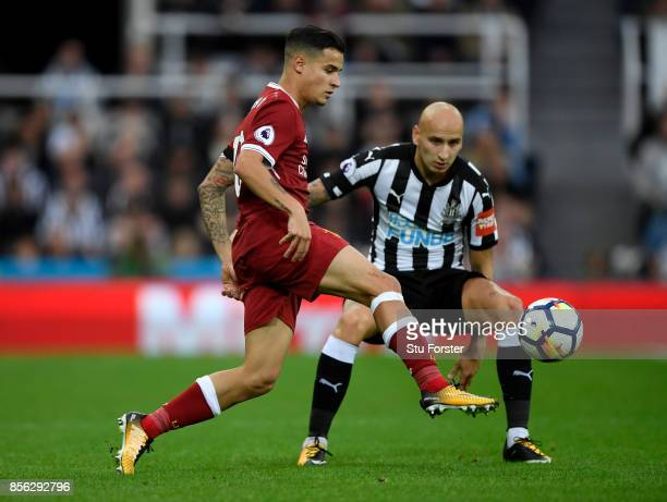 Philippe Coutinho of Liverpool and Jonjo Shelvey of Newcastle United battle for possession during the Premier League match between Newcastle United...