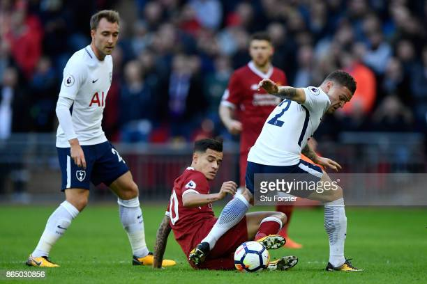 Philippe Coutinho of Liverpool and Kieran Trippier of Tottenham Hotspur battle for possession during the Premier League match between Tottenham...