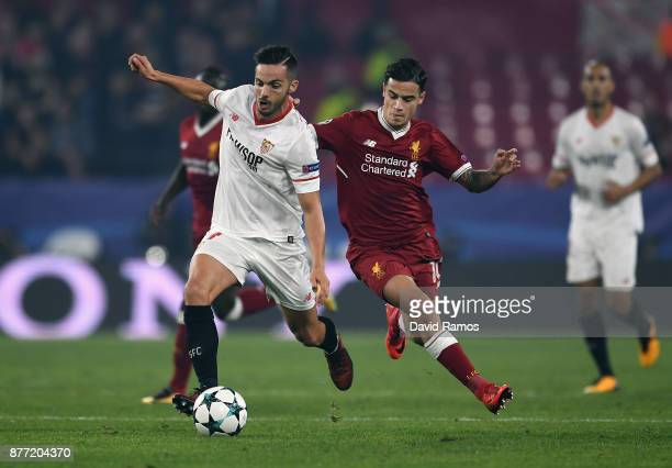 Philippe Coutinho of Liverpool and Pablo Sarabia of Sevilla battle for possession during the UEFA Champions League group E match between Sevilla FC...