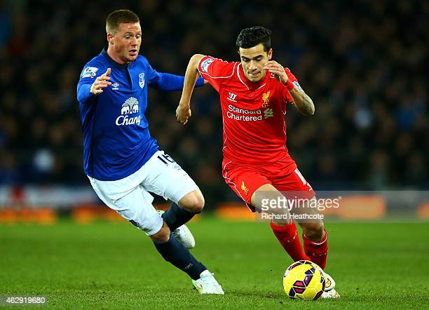 Philippe Coutinho of Liverpool battles for the ball with James McCarthy of Everton during the Barclays Premier League match between Everton and...