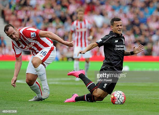 Philippe Coutinho of Liverpool brought down by Charlie Adam of Stoke City during the Barclays Premier League match between Stoke City and Liverpool...