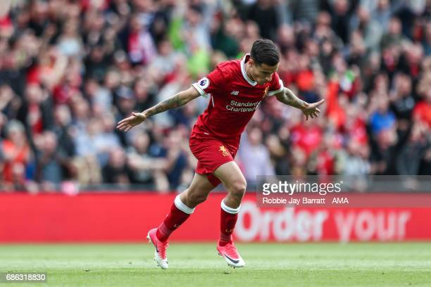 Philippe Coutinho of Liverpool celebrates after scoring a goal to make it 20 during the Premier League match between Liverpool and Middlesbrough at...