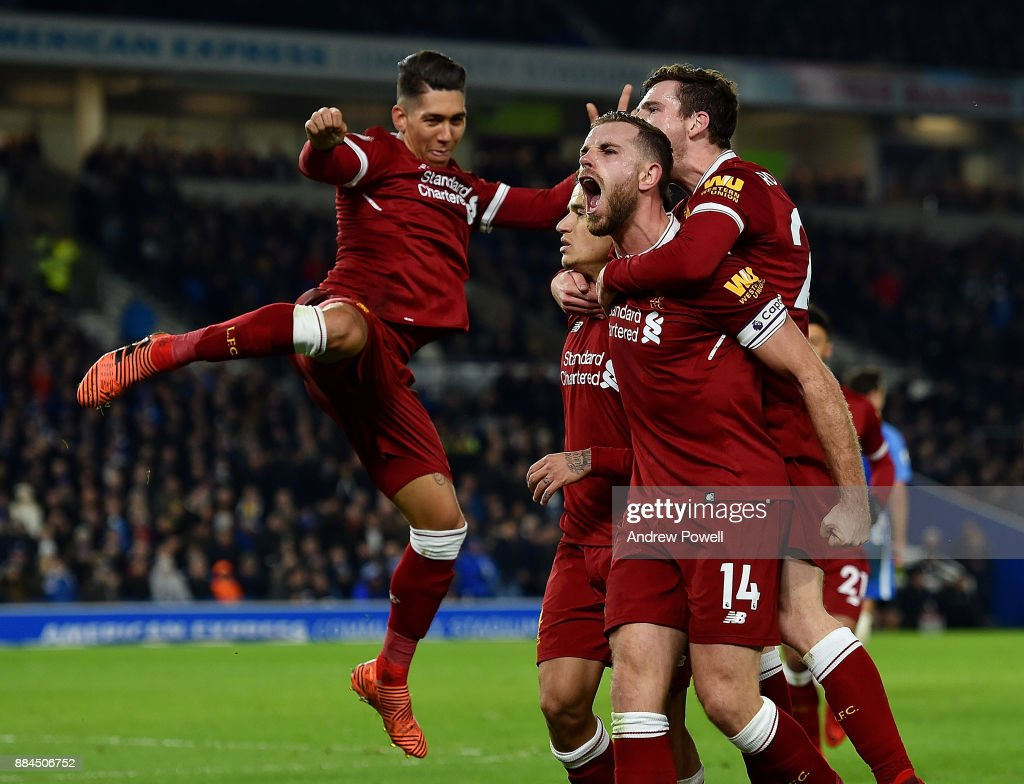 Philippe Coutinho of Liverpool celebrates after scoring during the Premier League match between Brighton and Hove Albion and Liverpool at Amex Stadium on December 2, 2017 in Brighton, England.