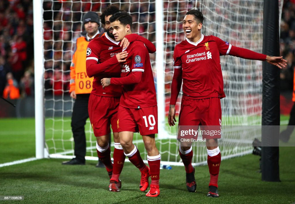 Philippe Coutinho of Liverpool celebrates after scoring his sides fifth goal with Mohamed Salah of Liverpool and Roberto Firmino of Liverpool during the UEFA Champions League group E match between Liverpool FC and Spartak Moskva at Anfield on December 6, 2017 in Liverpool, United Kingdom.