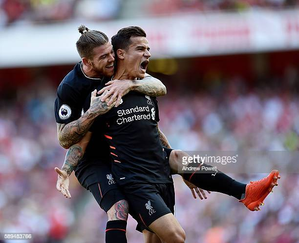 Philippe Coutinho of Liverpool celebrates after scoring the equalising goal during the Premier League match between Arsenal and Liverpool at Emirates...
