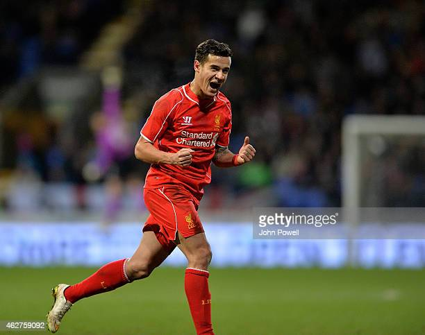 Philippe Coutinho of Liverpool celebrates after scoring the winning goal during the FA Cup Fourth Round Replay match between Bolton Wanderers and...