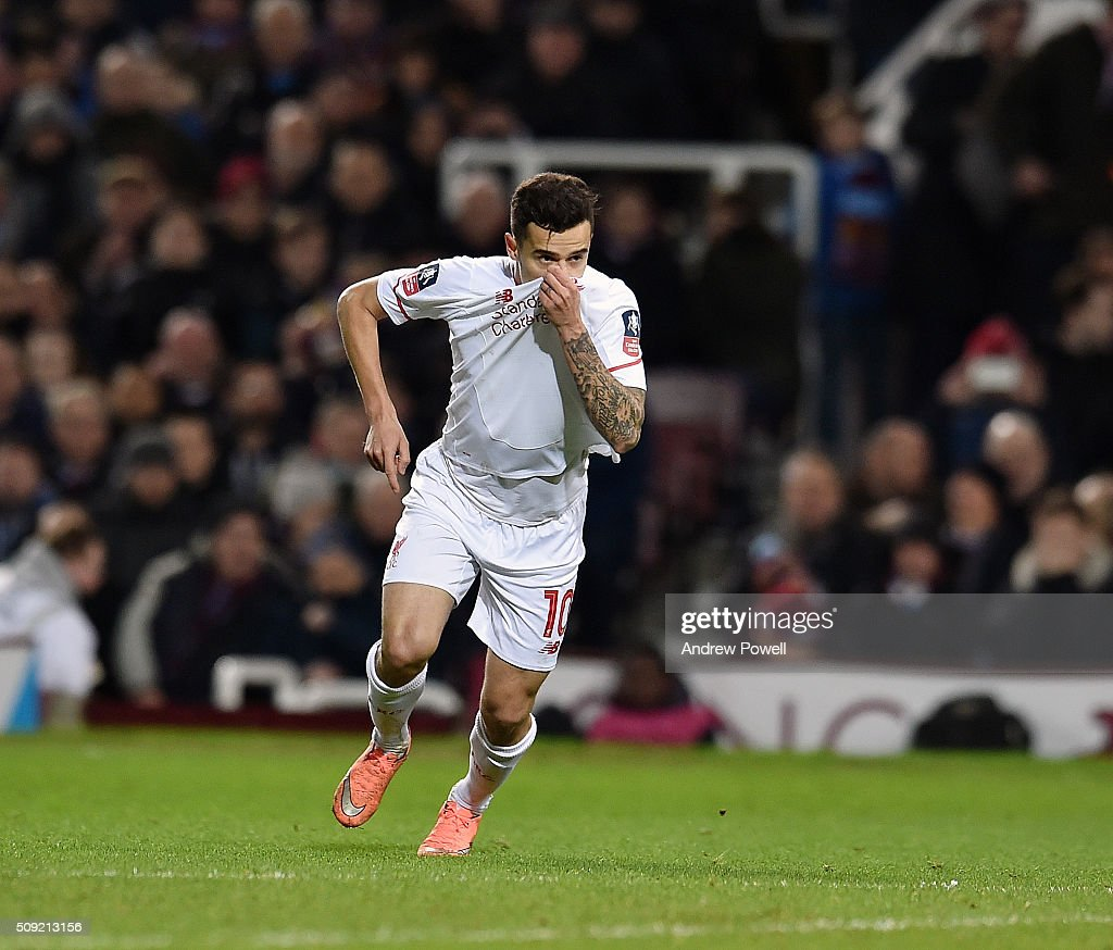 <a gi-track='captionPersonalityLinkClicked' href=/galleries/search?phrase=Philippe+Coutinho&family=editorial&specificpeople=6735575 ng-click='$event.stopPropagation()'>Philippe Coutinho</a> of Liverpool celebrates by kissing the Liverpool badge after scoring a free-kick during the The Emirates FA Cup Fourth Round Replay match between West Ham United and Liverpool at Boleyn Ground on February 9, 2016 in London, England.