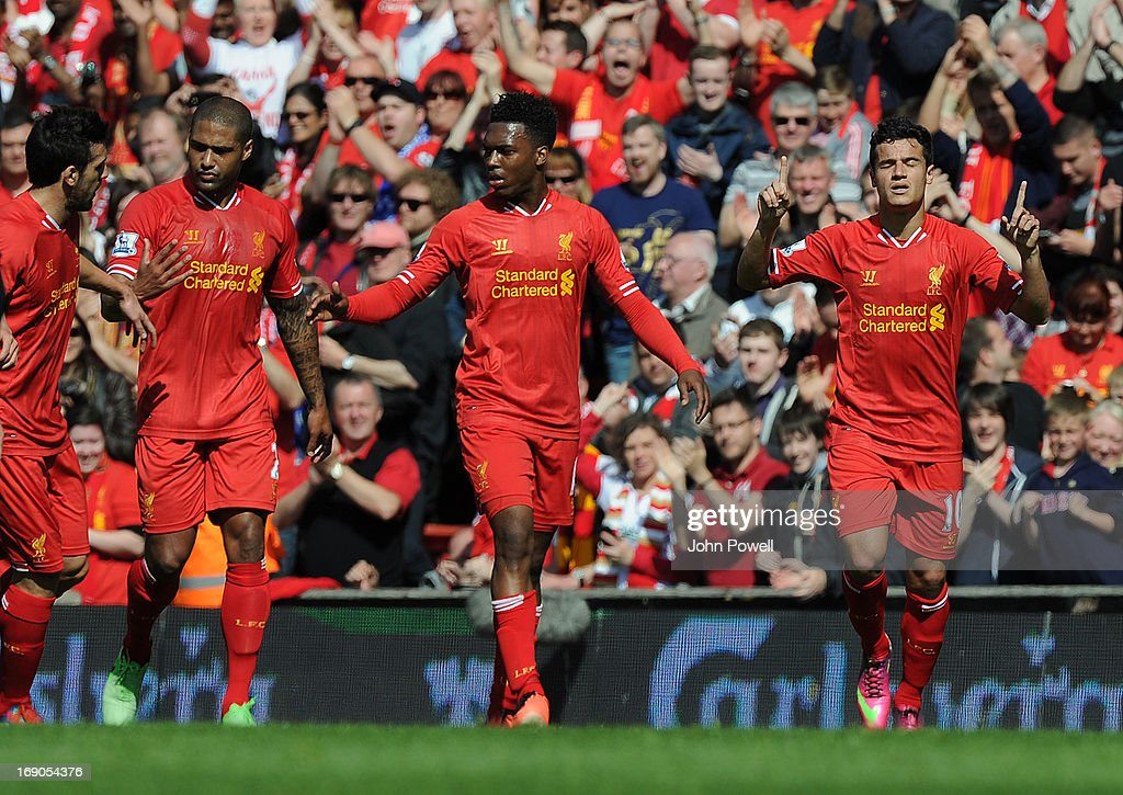 Philippe Coutinho of Liverpool celebrates his goal during the Barclays Premier League match between Liverpool and Queens Park Rangers at Anfield on May 19, 2013 in Liverpool England.