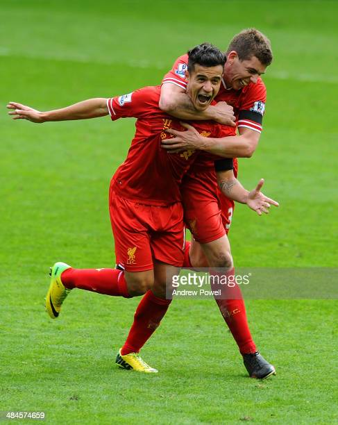 Philippe Coutinho of Liverpool celebrates his goal with Jon Flanagan during the Barclays Premier Leuage match between Liverpool and Manchester City...