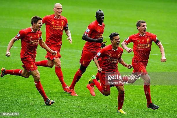 Philippe Coutinho of Liverpool celebrates his goal with Steven Gerrard and team mates to make it 32 during the Barclays Premier Leuage match between...