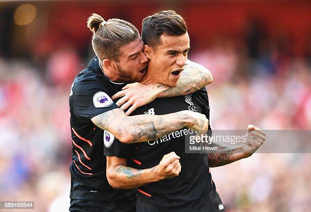 Philippe Coutinho of Liverpool celebrates scoring his free kick with Alberto Moreno during the Premier League match between Arsenal and Liverpool at...