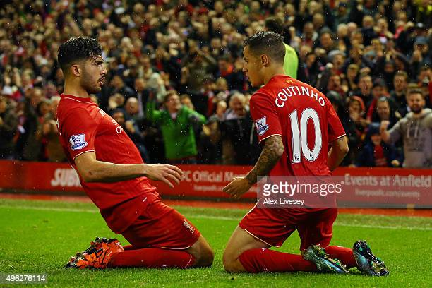 Philippe Coutinho of Liverpool celebrates scoring his side's first goal with Emre Can of Liverpool during the Barclays Premier League match between...
