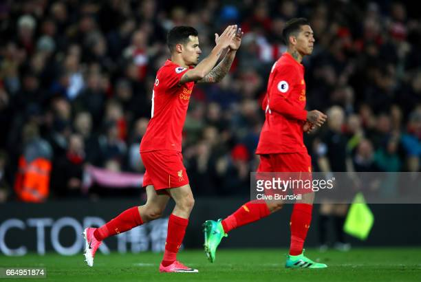 Philippe Coutinho of Liverpool celebrates scoring his sides first goal during the Premier League match between Liverpool and AFC Bournemouth at...