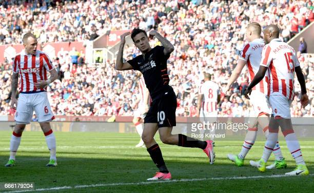 Philippe Coutinho of Liverpool celebrates scoring his sides first goal during the Premier League match between Stoke City and Liverpool at Bet365...