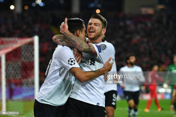 Philippe Coutinho of Liverpool celebrates scoring his sides first goal with Alberto Moreno of Liverpool during the UEFA Champions League group E...