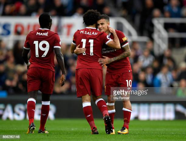 Philippe Coutinho of Liverpool celebrates scoring his sides first goal with Mohamed Salah of Liverpool during the Premier League match between...