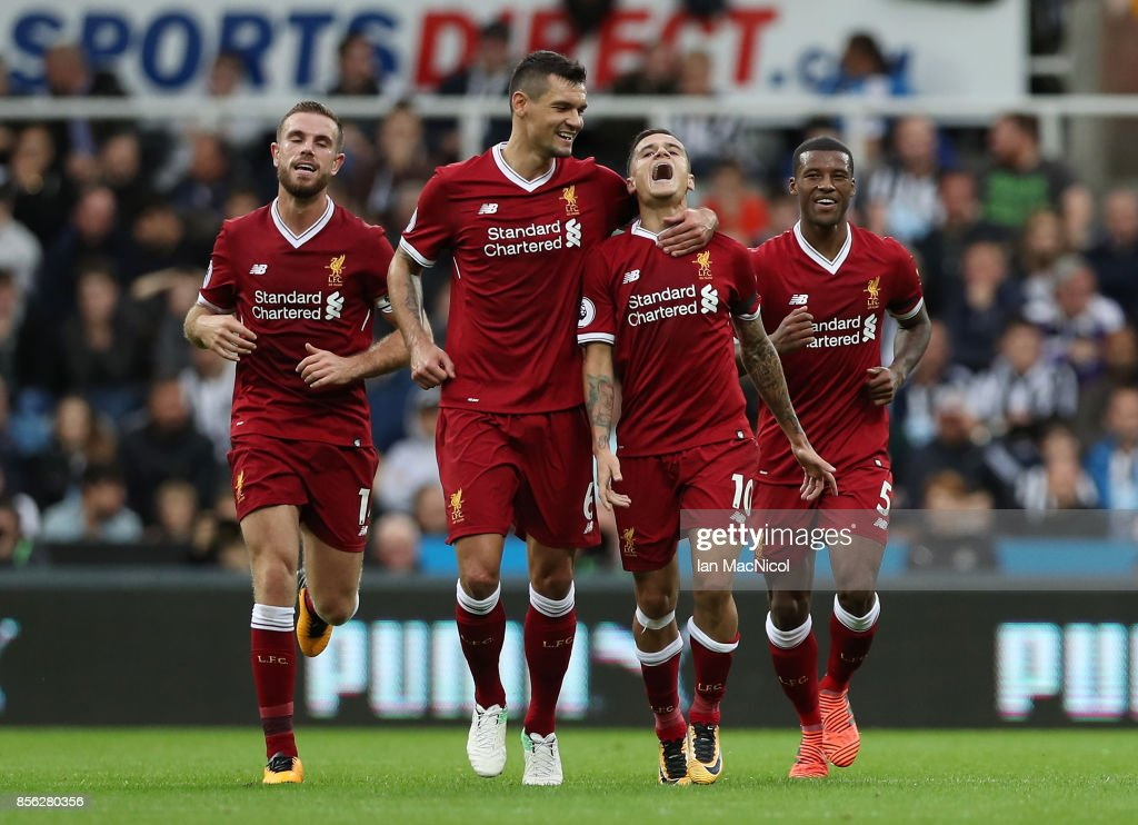 Philippe Coutinho of Liverpool celebrates scoring his sides first goal with Dejan Lovren of Liverpool during the Premier League match between Newcastle United and Liverpool at St. James Park on October 1, 2017 in Newcastle upon Tyne, England.