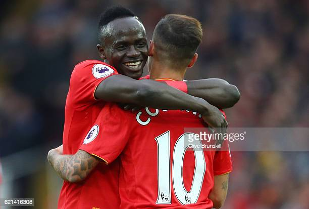 Philippe Coutinho of Liverpool celebrates scoring his sides second goal with Sadio Mane of Liverpool during the Premier League match between...
