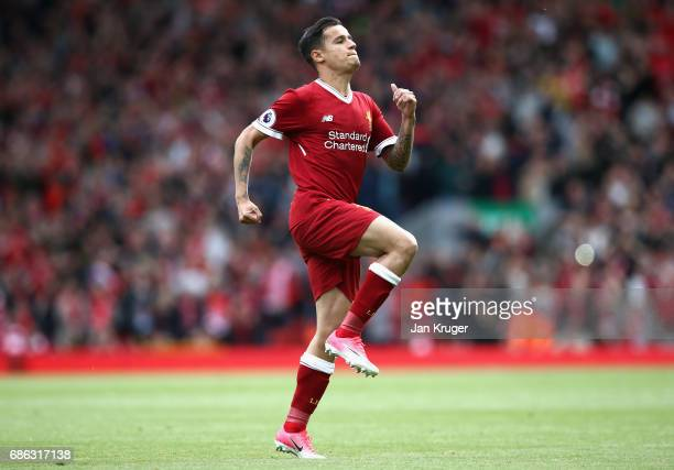Philippe Coutinho of Liverpool celebrates scoring his sides second goal during the Premier League match between Liverpool and Middlesbrough at...