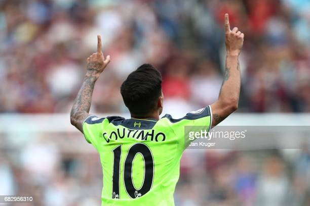 Philippe Coutinho of Liverpool celebrates scoring his sides third goal during the Premier League match between West Ham United and Liverpool at...