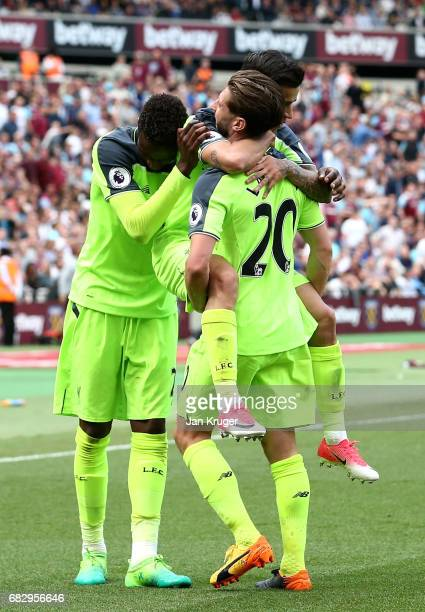 Philippe Coutinho of Liverpool celebrates scoring his sides third goal with Adam Lallana of Liverpool during the Premier League match between West...