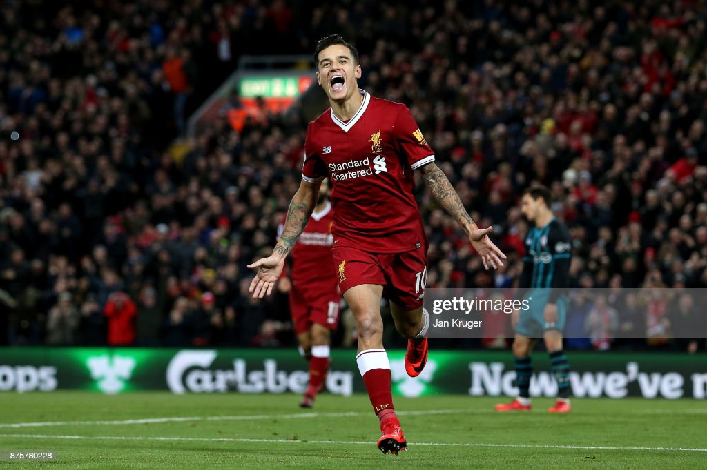 Philippe Coutinho of Liverpool celebrates scoring his side's third goal during the Premier League match between Liverpool and Southampton at Anfield on November 18, 2017 in Liverpool, England.