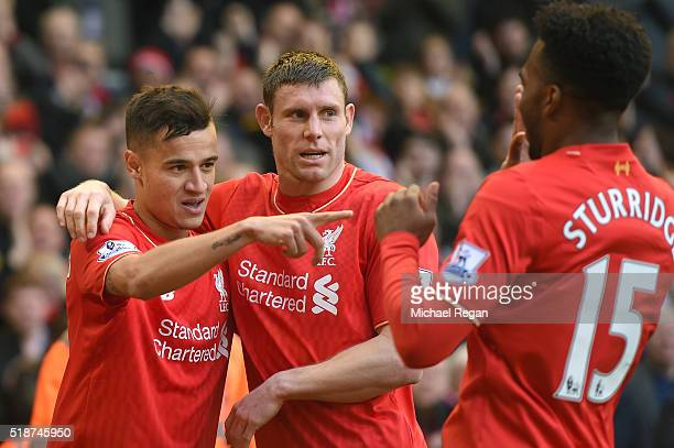 Philippe Coutinho of Liverpool celebrates scoring his team's first goal with his team mates James Milner and Daniel Sturridge during the Barclays...