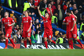 Philippe Coutinho of Liverpool celebrates scoring his team's second goal during the Barclays Premier League match between Chelsea and Liverpool at...