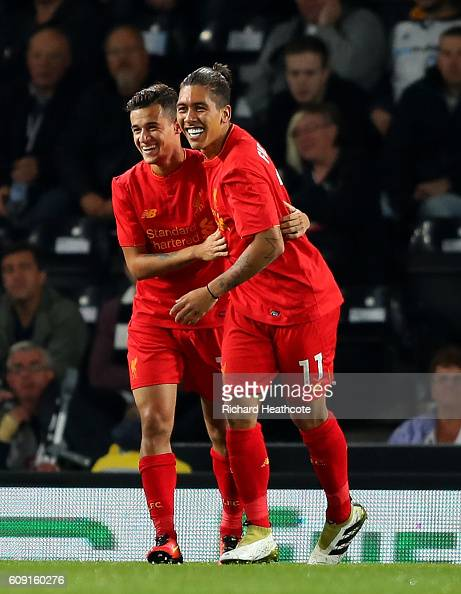 Philippe Coutinho of Liverpool celebrates scoring his team's second goal with Roberto Firmino during the EFL Cup Third Round match between Derby...