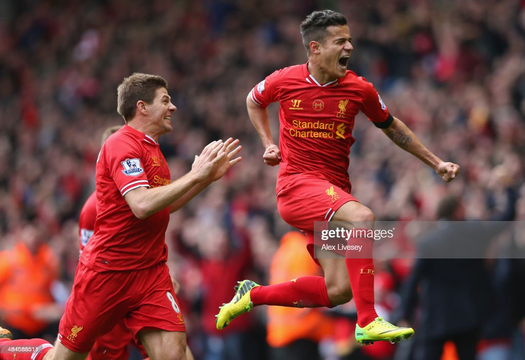 <a gi-track='captionPersonalityLinkClicked' href=/galleries/search?phrase=Philippe+Coutinho&family=editorial&specificpeople=6735575 ng-click='$event.stopPropagation()'>Philippe Coutinho</a> of Liverpool celebrates scoring his team's third goal during the Barclays Premier League match between Liverpool and Manchester City at Anfield on April 13, 2014 in Liverpool, England.