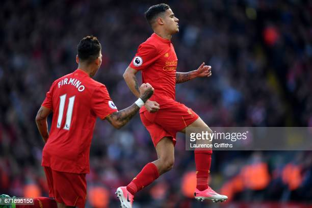 Philippe Coutinho of Liverpool celebrates scoring the opening goal from a free kick during the Premier League match between Liverpool and Crystal...