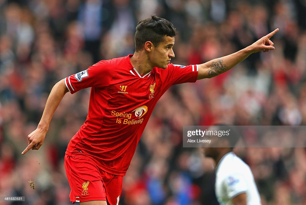 <a gi-track='captionPersonalityLinkClicked' href=/galleries/search?phrase=Philippe+Coutinho&family=editorial&specificpeople=6735575 ng-click='$event.stopPropagation()'>Philippe Coutinho</a> of Liverpool celebrates scoring the third goal during the Barclays Premier League match between Liverpool and Tottenham Hotspur at Anfield on March 30, 2014 in Liverpool, England.