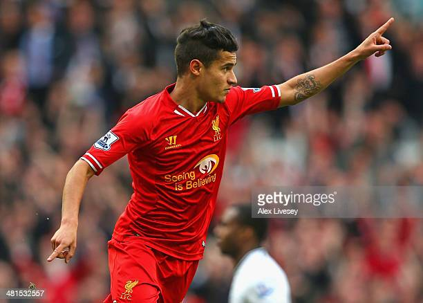 Philippe Coutinho of Liverpool celebrates scoring the third goal during the Barclays Premier League match between Liverpool and Tottenham Hotspur at...
