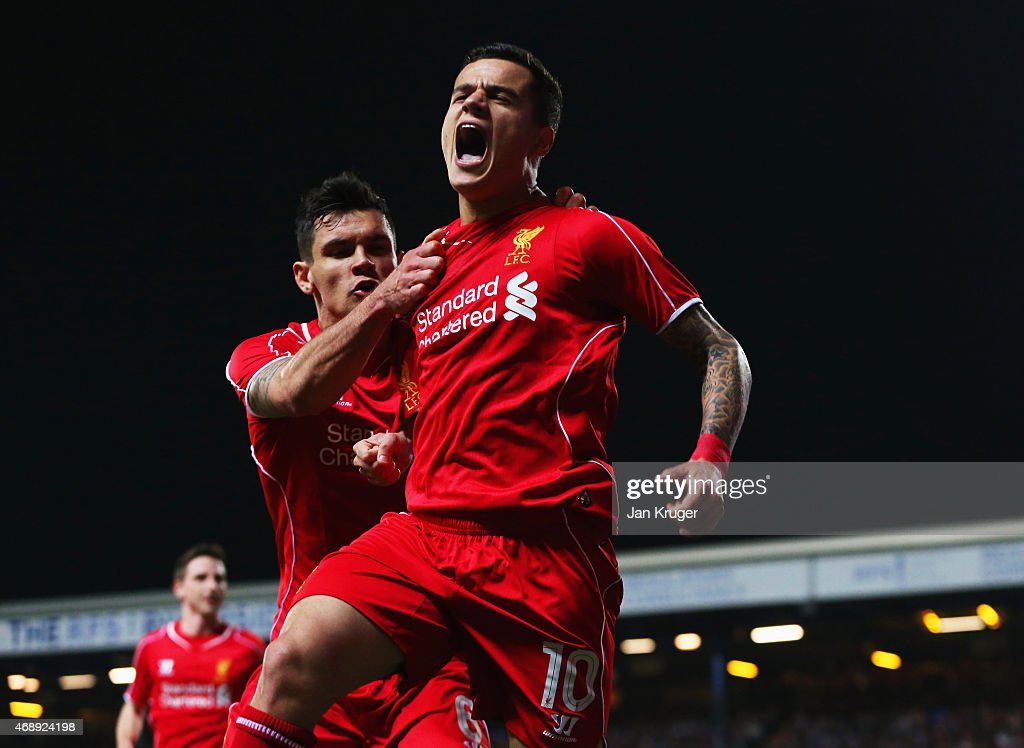 <a gi-track='captionPersonalityLinkClicked' href=/galleries/search?phrase=Philippe+Coutinho&family=editorial&specificpeople=6735575 ng-click='$event.stopPropagation()'>Philippe Coutinho</a> of Liverpool (10) celebrates with <a gi-track='captionPersonalityLinkClicked' href=/galleries/search?phrase=Dejan+Lovren&family=editorial&specificpeople=5577379 ng-click='$event.stopPropagation()'>Dejan Lovren</a> as he scores their first goal during the FA Cup Quarter Final Replay match between Blackburn Rovers and Liverpool at Ewood Park on April 8, 2015 in Blackburn, England.