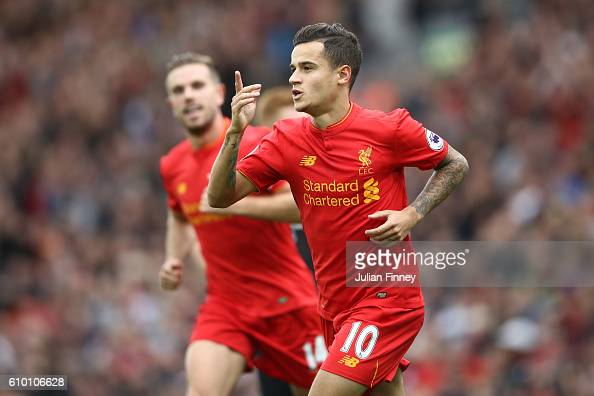 Philippe Coutinho of Liverpool celebrates with Sadio Mane as he scores their fourth goal during the Premier League match between Liverpool and Hull...