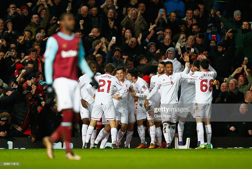 Philippe Coutinho of Liverpool (C) celebrates with team mates as he scores their first and equalising goal during the Emirates FA Cup Fourth Round Replay match between West Ham United and Liverpool at Boleyn Ground on February 9, 2016 in London, England.