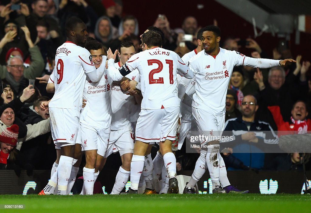 <a gi-track='captionPersonalityLinkClicked' href=/galleries/search?phrase=Philippe+Coutinho&family=editorial&specificpeople=6735575 ng-click='$event.stopPropagation()'>Philippe Coutinho</a> of Liverpool (2L) celebrates with team mates as he scores their first and equalising goal during the Emirates FA Cup Fourth Round Replay match between West Ham United and Liverpool at Boleyn Ground on February 9, 2016 in London, England.