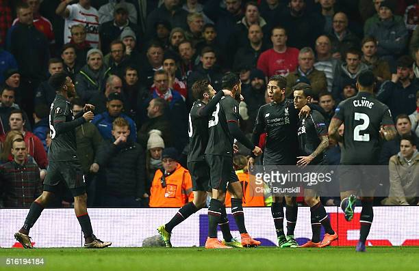 Philippe Coutinho of Liverpool celebrates with team mates as he scores their first goal during the UEFA Europa League round of 16 second leg match...