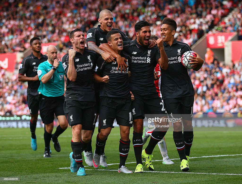 Philippe Coutinho of Liverpool (10) celebrates with team mates James Milner, Martin Skrtel, Emre Can and Roberto Firmino of Liverpool as he scores their first goal during the Barclays Premier League match between Stoke City and Liverpool at Brittania Stadium on August 9, 2015 in Stoke on Trent, England.
