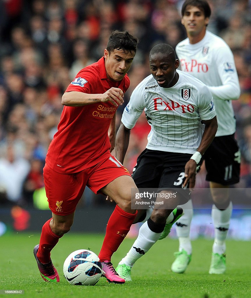 Philippe Coutinho of Liverpool competes with Eyong Enoh of Fulham during the Barclays Premier League Match between Fulham and Liverpool at Craven Cottage on May 12, 2013 in London, England.