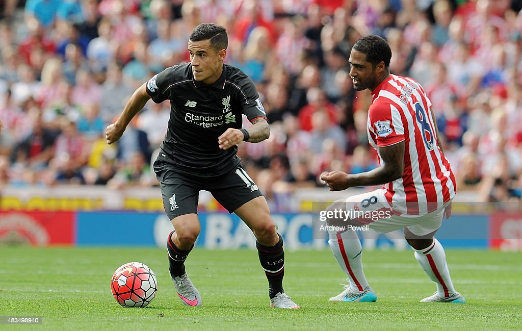 Philippe Coutinho of Liverpool competes with Glen Johnson of Stoke City during the Barclays Premier League match between Stoke City and Liverpool at Britannia Stadium on August 9, 2015 in Stoke on Trent, England.