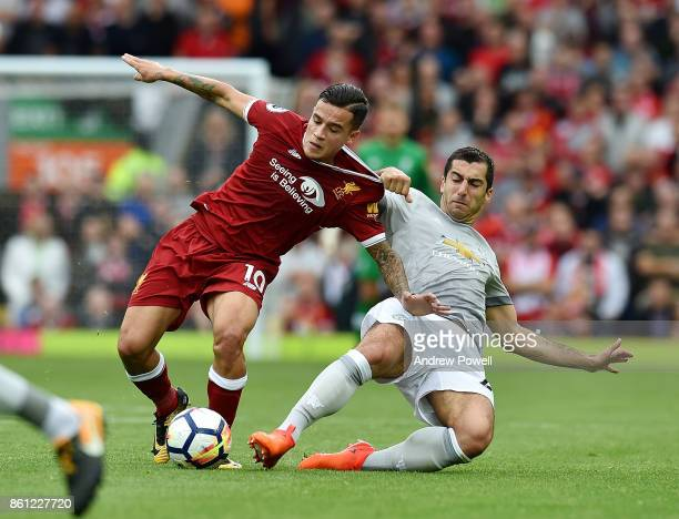Philippe Coutinho of Liverpool competes with Henrikh Mkhitaryan of Manchester United during the Premier League match between Liverpool and Manchester...
